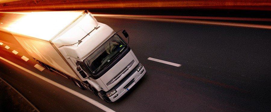 bigstock-Truck-On-Highway-4535670