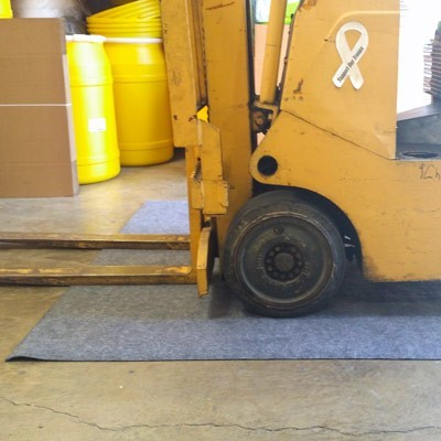forklift mat protects warehouse floor
