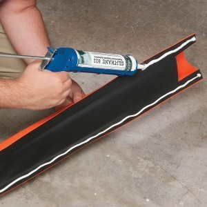 apply floor sealant caulking to spill barrier