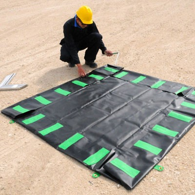 oil containment berm with aluminum L-brackets