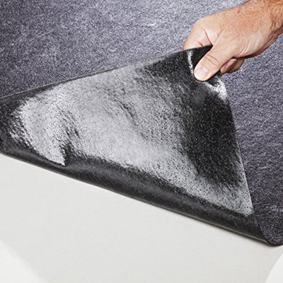 Adhesive-backed non-slip absorbent floor mat