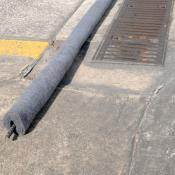 Trench drain filter boom for oil contaminants