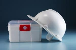 first aid kit and contstruction hard hat